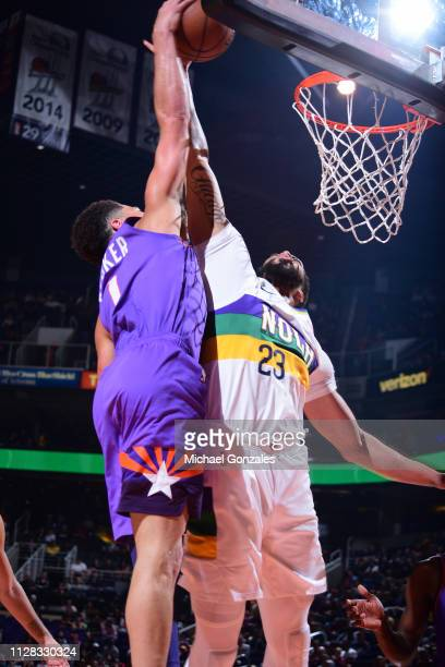 Devin Booker of the Phoenix Suns dunks the ball against Anthony Davis of the New Orleans Pelicans on March 1 2019 at Talking Stick Resort Arena in...