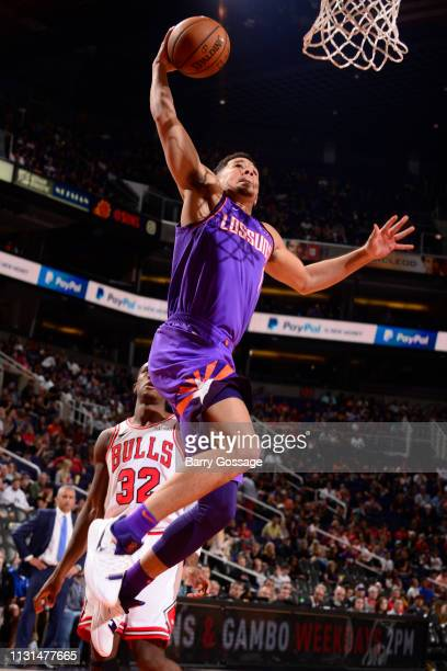 Devin Booker of the Phoenix Suns dunks the ball against the Chicago Bulls on March 18 2019 at Talking Stick Resort Arena in Phoenix Arizona NOTE TO...