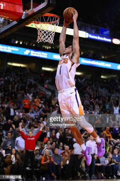 Devin Booker of the Phoenix Suns goes up for a slam dunk against the Philadelphia 76ers during the second half of the NBA game at Talking Stick...