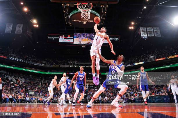 Devin Booker of the Phoenix Suns goes up for against a dunk against the Philadelphia 76ers on November 4 2019 at Talking Stick Resort Arena in...