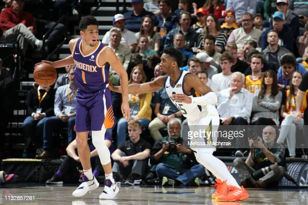 Devin Booker of the Phoenix Suns handles the ball against Donovan Mitchell of the Utah Jazz on March 25 2019 at vivintSmartHome Arena in Salt Lake...