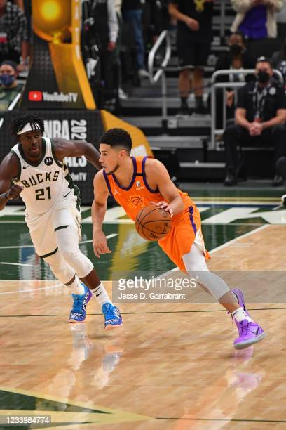 Devin Booker of the Phoenix Suns handles the ball against Jrue Holiday of the Milwaukee Bucks during Game Four of the 2021 NBA Finals on July 14,...
