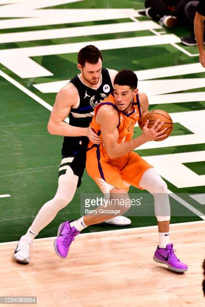 Devin Booker of the Phoenix Suns handles the ball against the Milwaukee Bucks during Game Six of the 2021 NBA Finals on July 20, 2021 at the Fiserv...
