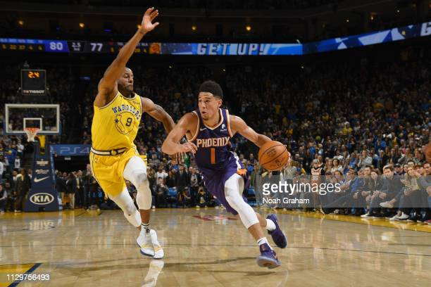 Devin Booker of the Phoenix Suns handles the ball against the Golden State Warriors on March 10 2019 at ORACLE Arena in Oakland California NOTE TO...