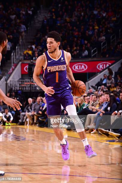 Devin Booker of the Phoenix Suns handles the ball against the Golden State Warriors on October 30 2019 at Chase Center in San Francisco California...