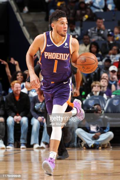 Devin Booker of the Phoenix Suns handles the ball against the Memphis Grizzlies on November 2 2019 at FedExForum in Memphis Tennessee NOTE TO USER...