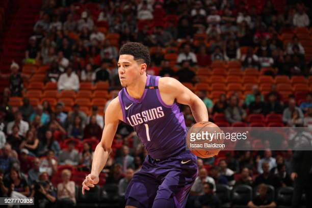 Devin Booker of the Phoenix Suns handles the ball against the Miami Heat on March 5 2018 at American Airlines Arena in Miami Florida NOTE TO USER...