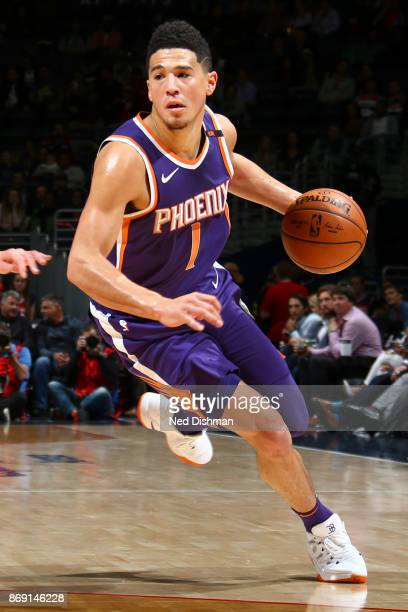 Devin Booker of the Phoenix Suns handles the ball against the Washington Wizards on November 1 2017 at Capital One Arena in Washington DC NOTE TO...