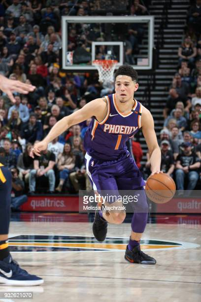 Devin Booker of the Phoenix Suns handles the ball against the Utah Jazz on March 15 2018 at vivintSmartHome Arena in Salt Lake City Utah NOTE TO USER...