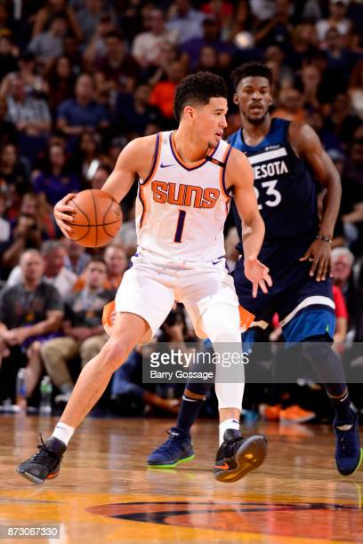 Devin Booker of the Phoenix Suns handles the ball during the game against the Minnesota Timberwolves on November 11 2017 at Talking Stick Resort...