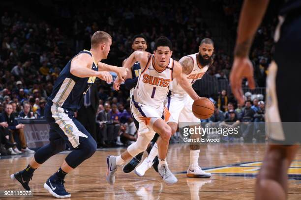 Devin Booker of the Phoenix Suns handles the ball during the game against the Denver Nuggets on January 19 2018 at the Pepsi Center in Denver...