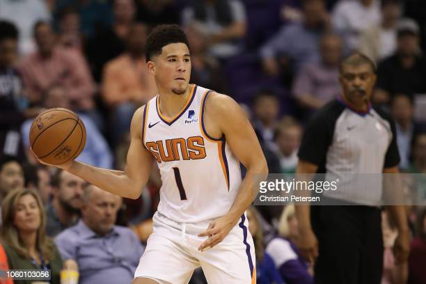 Devin Booker of the Phoenix Suns handles the ball during the NBA game against the Boston Celtics at Talking Stick Resort Arena on November 8 2018 in...