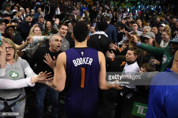 Devin Booker of the Phoenix Suns highfives with fans after scoring 70 points against the Boston Celtics on March 24 2017 at the TD Garden in Boston...