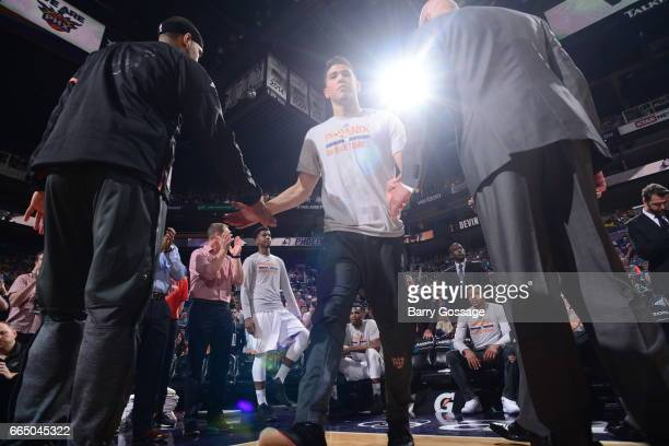 Devin Booker of the Phoenix Suns is introduced before the game against the Golden State Warriors on April 5 2017 at Talking Stick Resort Arena in...