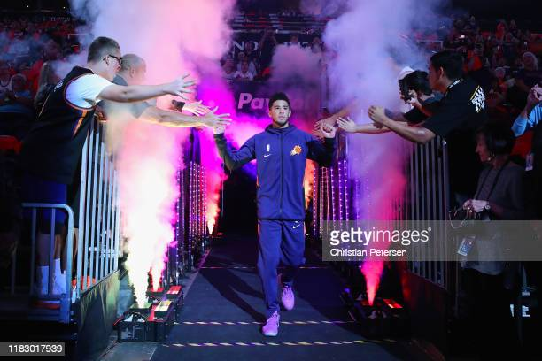 Devin Booker of the Phoenix Suns is introduced before the start of the NBA game against the Sacramento Kings at Talking Stick Resort Arena on October...