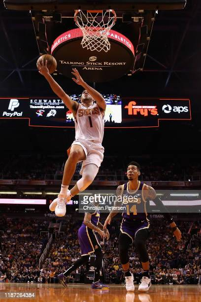 Devin Booker of the Phoenix Suns lays up a shot past Danny Green of the Los Angeles Lakers during the first half of the NBA game at Talking Stick...