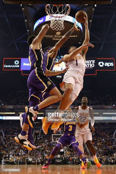 Devin Booker of the Phoenix Suns lays up a shot past Lonzo Ball of the Los Angeles Lakers during the first half of the NBA game at Talking Stick...