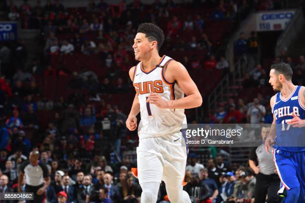 Devin Booker of the Phoenix Suns looks on during the game against the Philadelphia 76ers on December 4 2017 at Wells Fargo Center in Philadelphia...