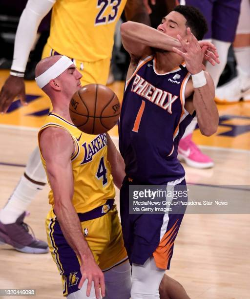Devin Booker of the Phoenix Suns looses the ball against Alex Caruso of the Los Angeles Lakers in the first half of game three of the Western...