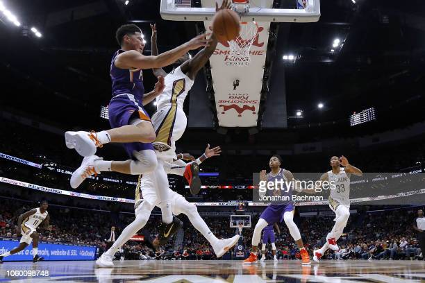 Devin Booker of the Phoenix Suns passes around Julius Randle of the New Orleans Pelicans during the second half at the Smoothie King Center on...