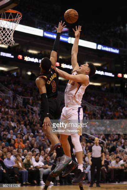 Devin Booker of the Phoenix Suns puts up a shot over Jordan Clarkson of the Cleveland Cavaliers during the second half of the NBA game at Talking...