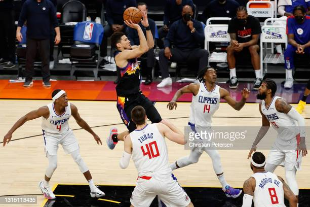 Devin Booker of the Phoenix Suns puts up a shot over Rajon Rondo, Ivica Zubac Terance Mann and Paul George of the LA Clippers during the second half...