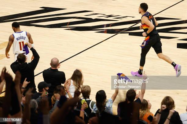 Devin Booker of the Phoenix Suns reacts after a three-point shot against the Denver Nuggets during the second half in Game Two of the Western...