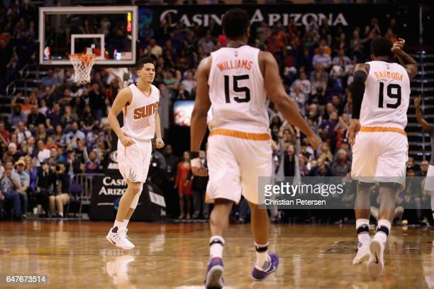 Devin Booker of the Phoenix Suns reacts after Leandro Barbosa hit a three point shot against the Oklahoma City Thunder during the second half of the...