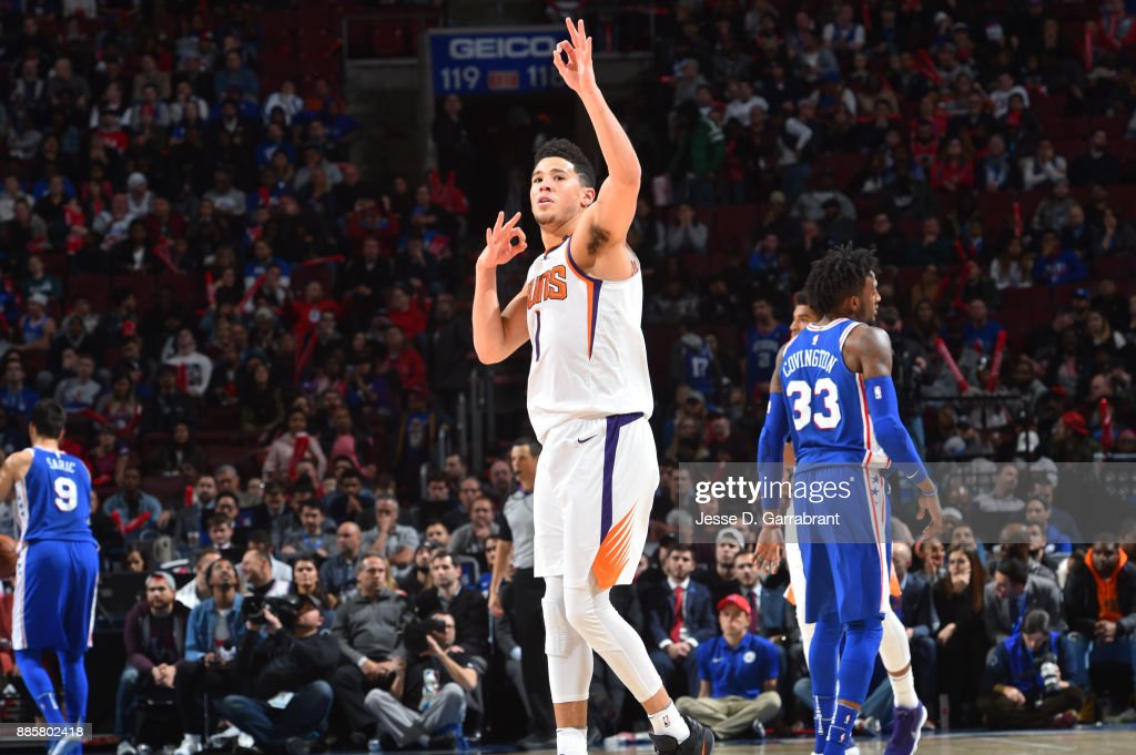 Devin Booker #1 of the Phoenix Suns reacts during the game against the Philadelphia 76ers on December 4, 2017 at Wells Fargo Center in Philadelphia, Pennsylvania.