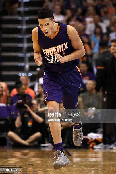 Devin Booker of the Phoenix Suns reacts to a missed shot against the Sacramento Kings during the first half of the NBA game at Talking Stick Resort...