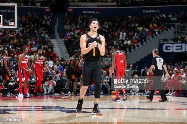 Devin Booker of the Phoenix Suns reacts to a play during the game against the Washington Wizards on December 22 2018 at Capital One Arena in...