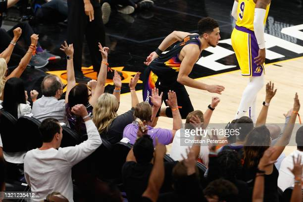 Devin Booker of the Phoenix Suns reacts to a three-point shot against the Los Angeles Lakers during the first half in Game Five of the Western...