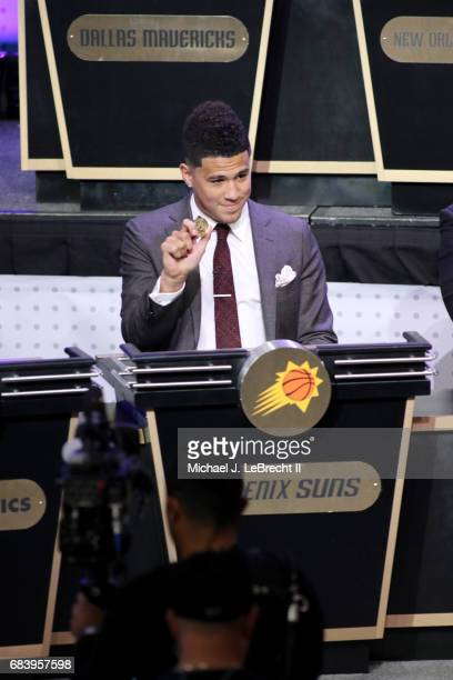 Devin Booker of the Phoenix Suns represents his team with his lucky charm during the 2017 NBA Draft Lottery at the New York Hilton in New York New...