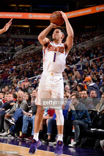 Devin Booker of the Phoenix Suns shoots a three point basket during the game against the Philadelphia 76ers on January 2 2019 at Talking Stick Resort...