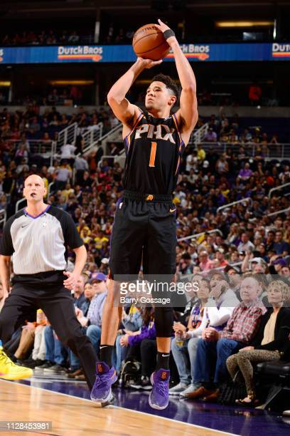 Devin Booker of the Phoenix Suns shoots a threepointer during the game during the game against the Los Angeles Lakers on March 2 2019 at Talking...