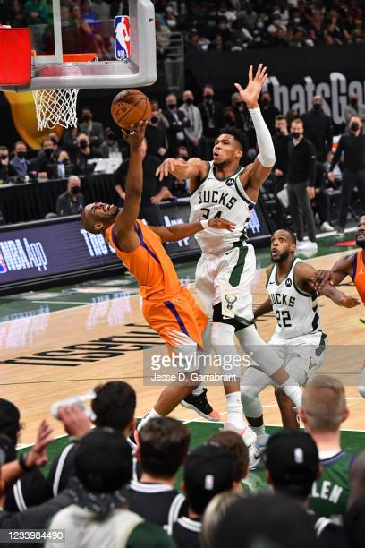 Devin Booker of the Phoenix Suns shoots the ball against Giannis Antetokounmpo of the Milwaukee Bucks during Game Four of the 2021 NBA Finals on July...