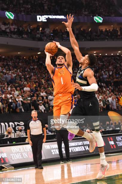Devin Booker of the Phoenix Suns shoots the ball against Giannis Antetokounmpo of the Milwaukee Bucks during Game Six of the 2021 NBA Finals on July...