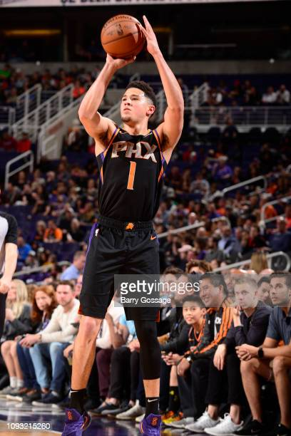 Devin Booker of the Phoenix Suns shoots the ball against the Atlanta Hawks on February 2 2019 at Talking Stick Resort Arena in Phoenix Arizona NOTE...
