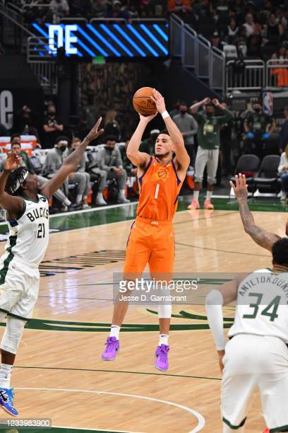 Devin Booker of the Phoenix Suns shoots the ball against the Milwaukee Bucks during Game Four of the 2021 NBA Finals on July 14, 2021 at Fiserv Forum...