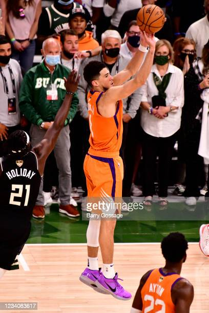 Devin Booker of the Phoenix Suns shoots the ball against the Milwaukee Bucks during Game Six of the 2021 NBA Finals on July 20, 2021 at the Fiserv...