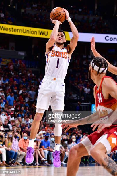 Devin Booker of the Phoenix Suns shoots the ball against the Denver Nuggets during Round 2, Game 4 of the 2021 NBA Playoffs on June 13, 2021 at the...