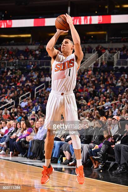 Devin Booker of the Phoenix Suns shoots the ball against the Charlotte Hornets on January 6 2016 at US Airways Center in Phoenix Arizona NOTE TO USER...