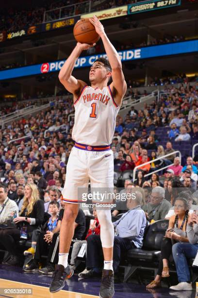 Devin Booker of the Phoenix Suns shoots the ball against the Oklahoma City Thunder on March 2 2018 at Talking Stick Resort Arena in Phoenix Arizona...