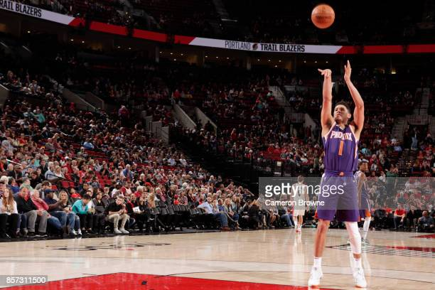 Devin Booker of the Phoenix Suns shoots the ball during a preseason game against the Portland Trail Blazers on October 3 2017 at the Moda Center in...