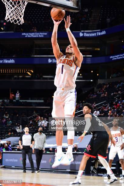 Devin Booker of the Phoenix Suns shoots the ball during the game against the Houston Rockets on April 12, 2021 at Phoenix Suns Arena in Phoenix,...