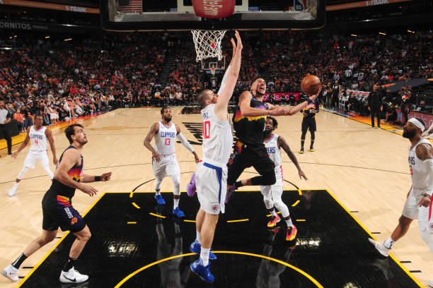 Devin Booker of the Phoenix Suns shoots the ball during the game against the LA Clippers during Game 1 of the Western Conference Finals of the 2021...