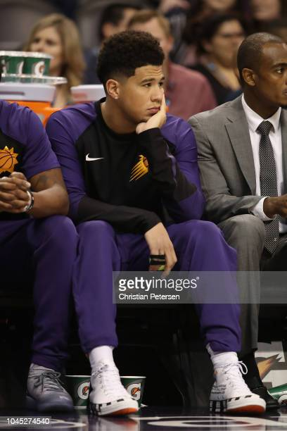 Devin Booker of the Phoenix Suns sits on the bench during the first half of the NBA game against the New Zealand Breakers at Talking Stick Resort...