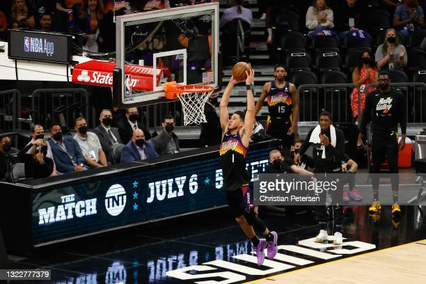 Devin Booker of the Phoenix Suns slam dunks the ball against the Denver Nuggets during the first half in Game Two of the Western Conference...