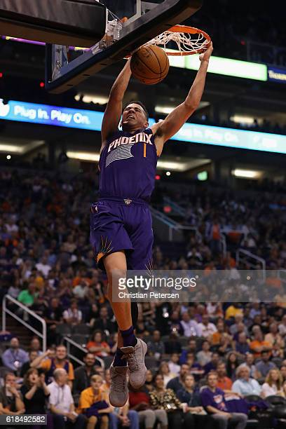 Devin Booker of the Phoenix Suns slam dunks the ball against the Sacramento Kings during the second half of the NBA game at Talking Stick Resort...