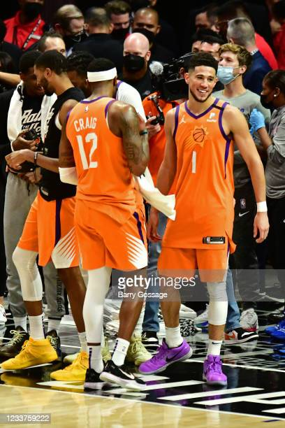 Devin Booker of the Phoenix Suns smiles after the game against the LA Clippers during Game 6 of the Western Conference Finals of the 2021 NBA...